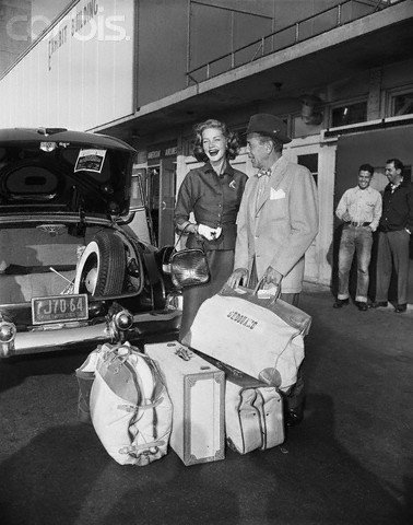 Original caption: 10/28/1953-New York, NY: Lauren Bacall and Humphrey Bogart on their arrival at LaGuardia airport for a vacation visit to New York. --- Image by © Bettmann/CORBIS